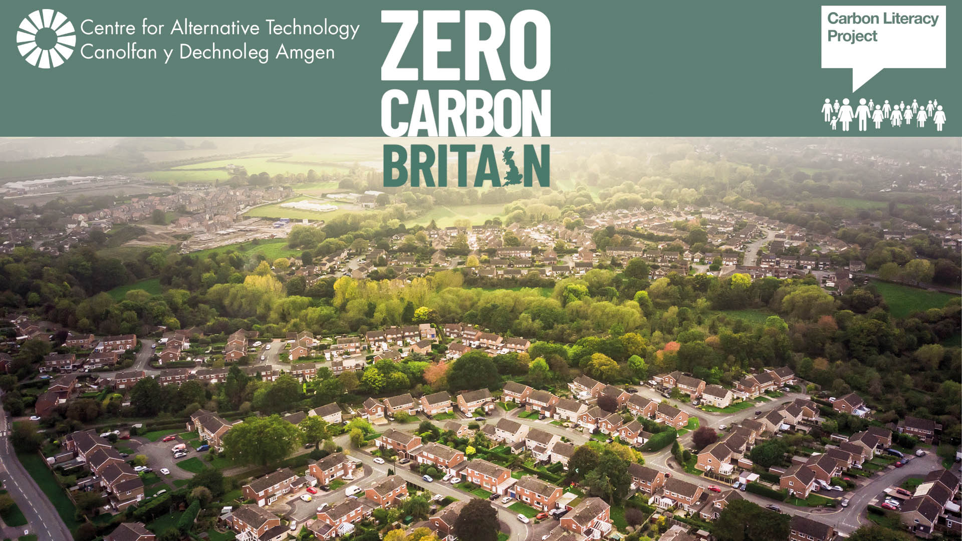 Aerial view of a town with Zero Carbon Britain logo