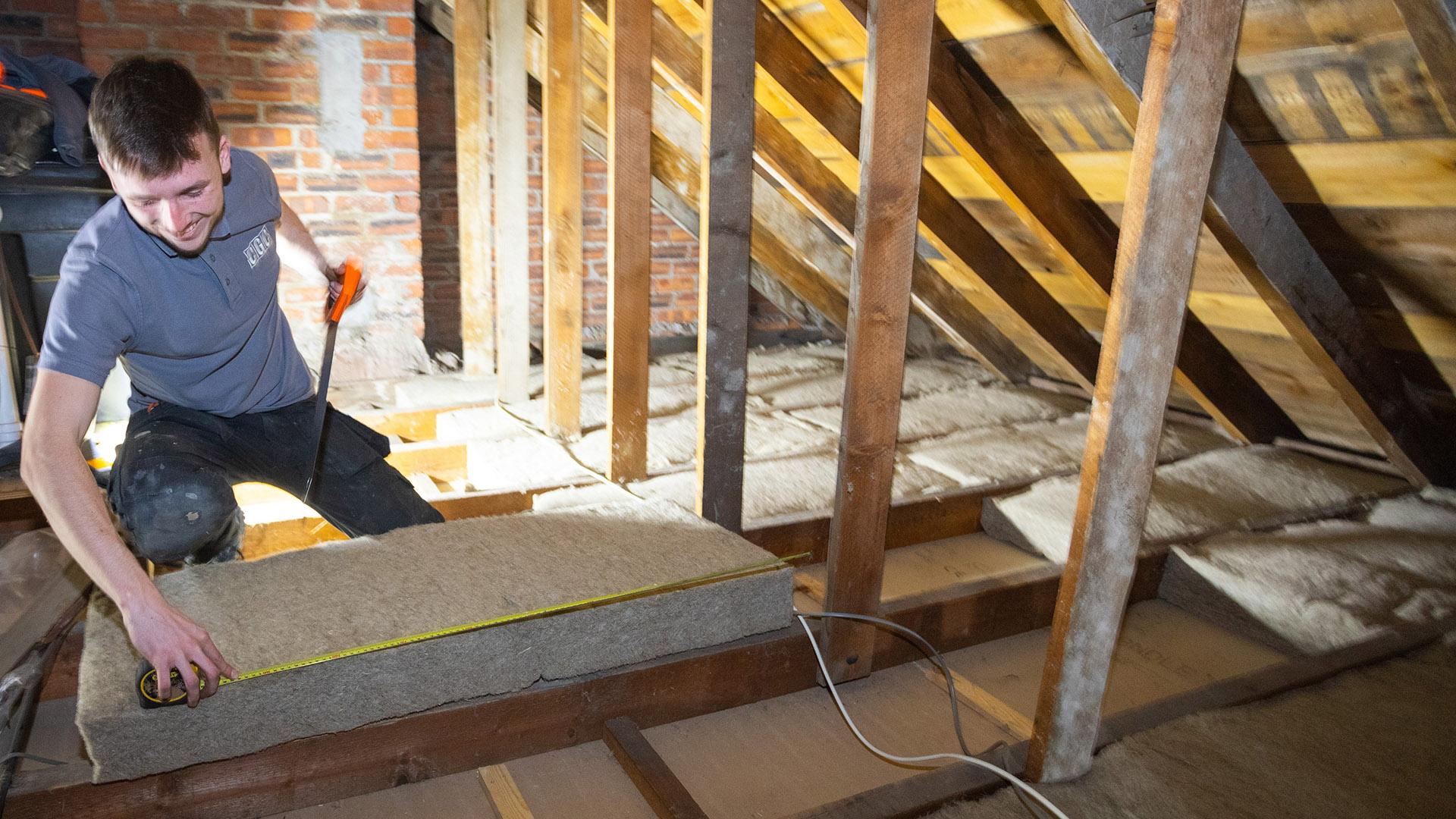 Insulation batts being installed