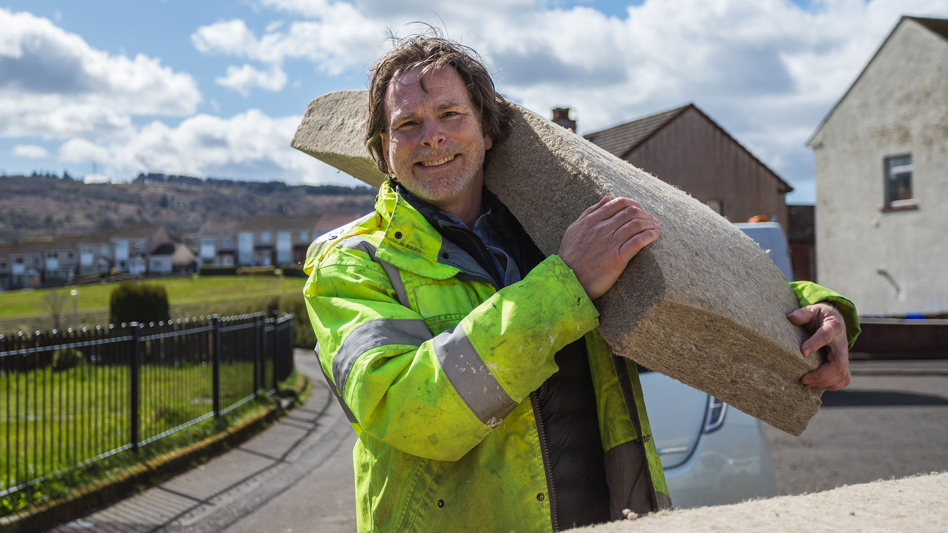 Scott holding IndiTherm, a flexible thermal insulation 'batt' made from UK-grown crops
